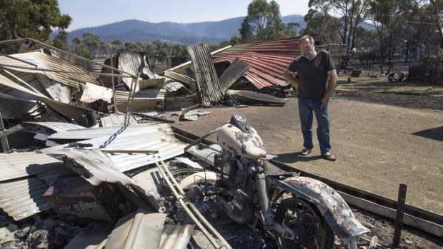 Mal Murdock surveys the damage to his property at Dunalley.