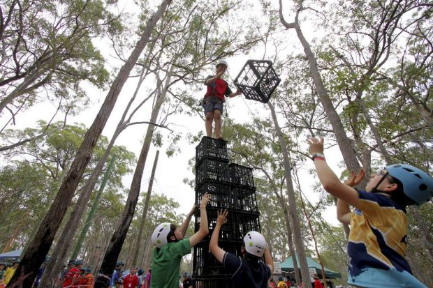 Jarrod Harrison, 13, from Frankston, Victoria, is helped by his fellow club members in the crate stacking challenge.