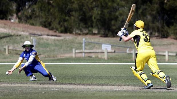 ACT fielder Sara Hungerford drops the ball off WA batter Jenny Wallace.