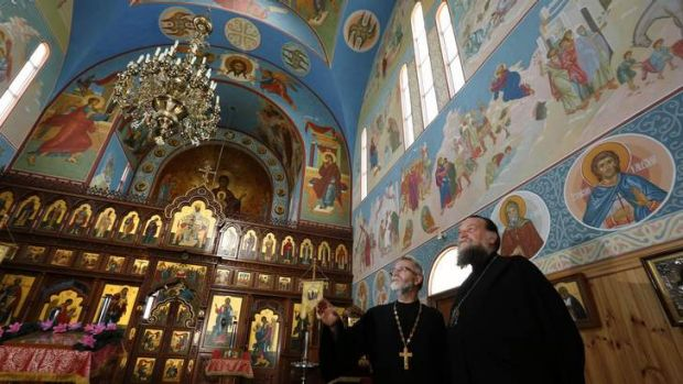 St John the Baptist Russian Orthodox Parish priest Father Alexander Morozow chats with iconographer Father Alexis ...