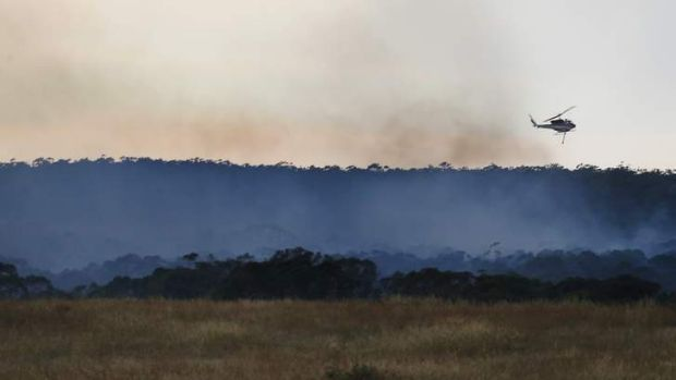 Fire crews mop up a fire at Aberfeldy Lane near Bungendore last month.