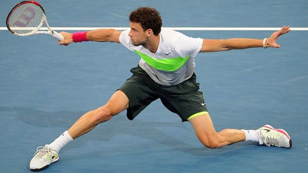 Young talent: Grigor Dimitrov, 21, of Bulgaria plays a backhand against Marcos Baghdatis, whom he beat in their ...
