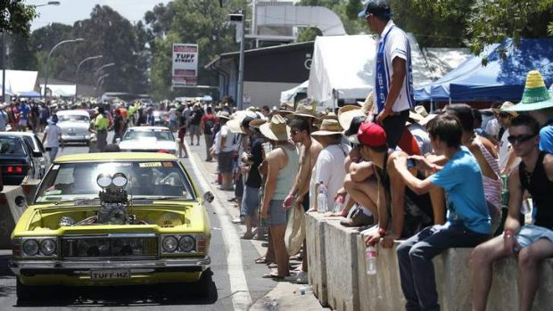 The Summernats crowd watches as cars cruise around at the EPIC grounds on Saturday.