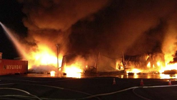 Fumes and fire ... the blaze at a tyre factory in Villawood on New Year's Day.