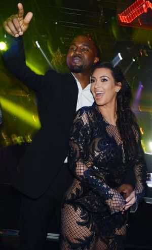 Parents-to-be ... Kanye West and Kim Kardashian celebrate New Year's Eve at 1OAK nightclub in Las Vegas.