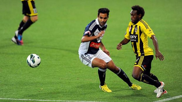 Stepping up: Wellington Phoenix's Benjamin Totori leads Melbourne Victory's Marcos Flores in the race for the ball at ...