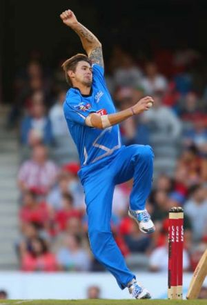 Kane Richardson bowls during the game against the Hurricanes.