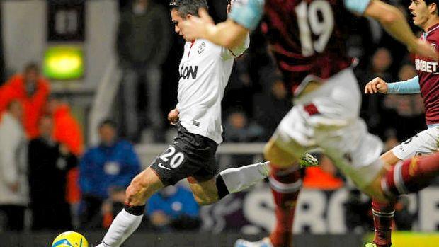 Injury time saviour ... Robin van Persie scores for Manchester United.