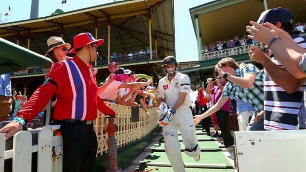 Michael Hussey of Australia walks out to bat for the last time in his Test career.
