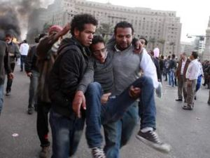 Protesters carry and injured man during clashes between protesters and police near Tahrir Square in Cairo in November 2011.