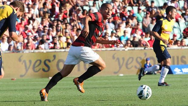 On the run … Western Sydney's Shinji Ono takes a through ball in midfield in the first half of the Wanderers' home ...
