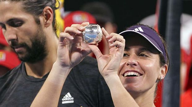 Anabel Medina Garrigues of Spain studies the diamond encrusted silver tennis ball she won with partner Fernando Verdasco ...