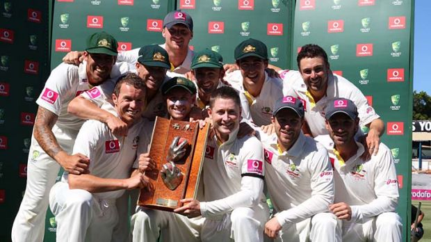 The Australian team with the series trophy.