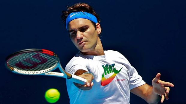 Finding the groove … Roger Federer steps up his Australian Open preparation with a hit at Melbourne Park on Sunday.