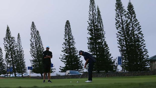 Matt Kuchar putts on the practice green during a weather delay in the Tournament of Champions at Kapalua, Hawaii.