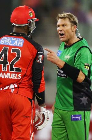 Finger spin … Warne and Samuels face off.