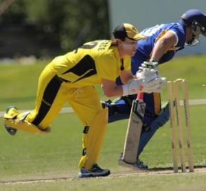 Meteors batter, Kris Britt just makes her ground as Fury wicketkeeper, Jenny Wallace, breaks the stumps.
