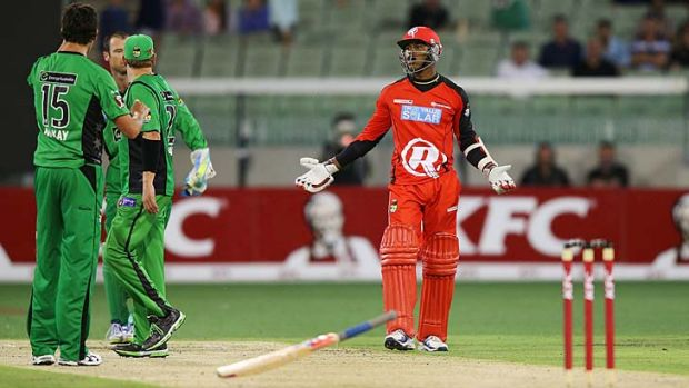 Marlon Samuels (right) throws his bat in front of Shane Warne during a heated exchange.