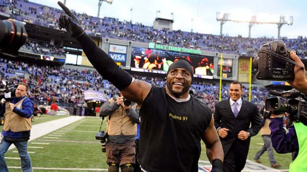 Ray Lewis takes a lap around the field after the Ravens win.