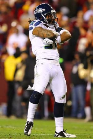 Seattle's Bruce Irvin celebrates sacking Robert Griffin III.