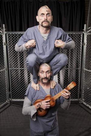 Breakout roles ... comedian Frank Woodley, bottom, and his acrobat doppelganger Simon Yates.