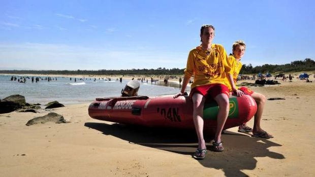 READY TO HELP: Sam Pettigrove, 23, and his brother Ted, 16, of Kambah, on patrol at Broulee beach. ''It's a lovely ...