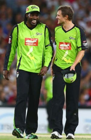 Losing and laughing: Chris Gayle and Dirk Nannes can smile even though Sydney Thunder has not won a match this season.