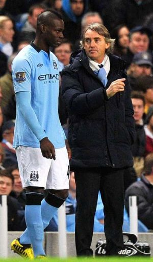 Go and do my bidding: Roberto Mancini prepares to send Mario Balotelli on as a substitute during the game against Watford.