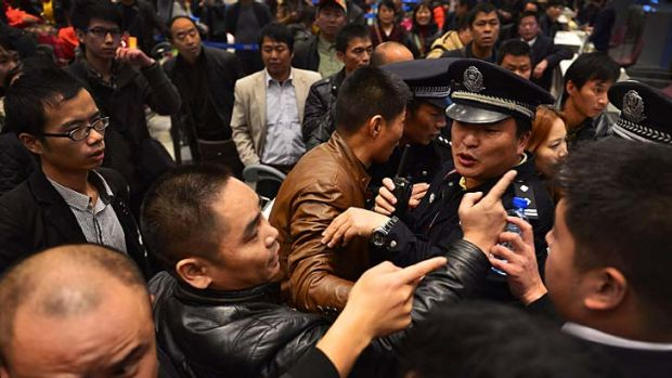 Stranded … angry travellers clashed with police