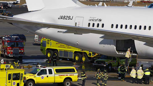 The Japan Airlines Boeing 787 Dreamliner is surrounded by emergency vehicles at Logan International Airport in Boston as ...