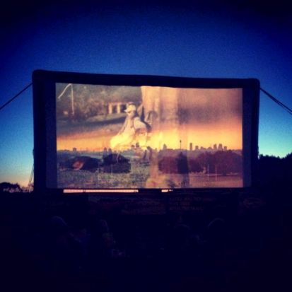 Moonlight cinema sunset and city skyline.