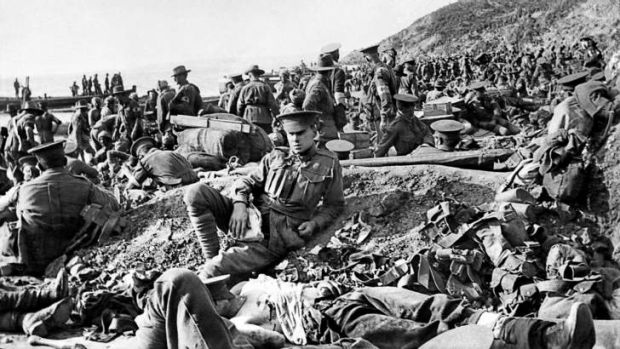 An Australian soldier lies wounded at Anzac Cove on the day of the Gallipoli landing, April 25, 1915. This scene is ...