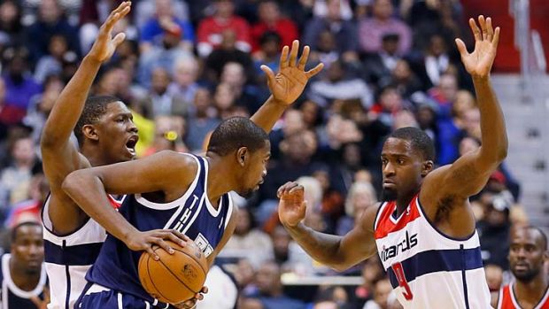 Kevin Seraphin (left) and Martell Webster (right) of the Washington Wizards pressure Kevin Durant of Oklahoma City ...