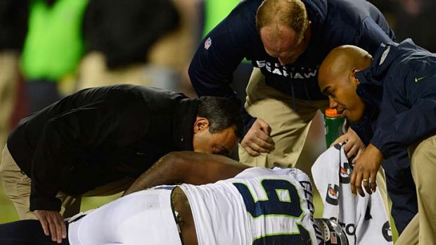 Chris Clemons of the Seattle Seahawks receives attention after being injured in the game against the Washington Redskins.