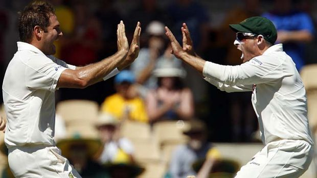 Good times … Ryan Harris celebrates with Mike Hussey.