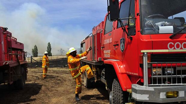 As the temperature rises, so do the fires ... the Rural Fire Service deals with a bushfire on Mount Forest Road near Cooma.