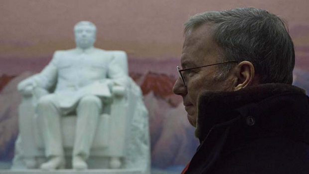 Eric Schmidt stands near a statue of the late North Korean leader Kim Il-sung.