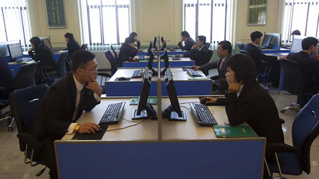 Look into the future ... North Korean students work at computer terminals inside a computer lab at Kim Il-sung ...