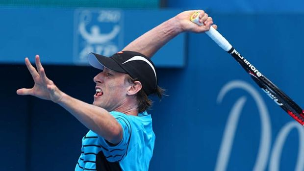 Fought hard ... John Millman, playing an overhead shot at Sydney Olympic Park on Wednesday, took a set off world no.23 ...