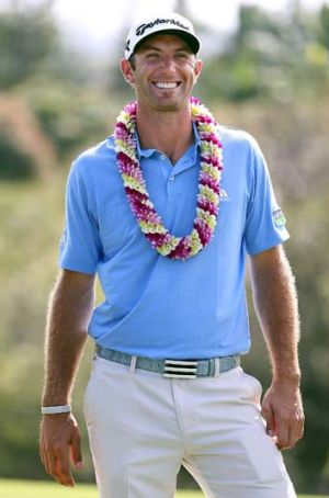 Dustin Johnson smiles after winning the truncated Tournament of Champions.