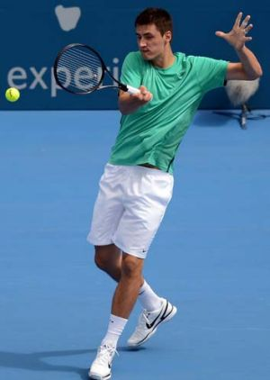 Bernard Tomic plays Florian Mayer of Germany at the Sydney International on Wednesday.
