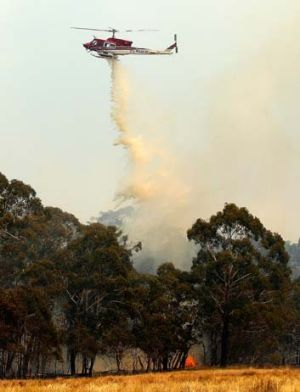 Water-bombing operations take place on a fire at Sandhills in Bungendore, NSW.