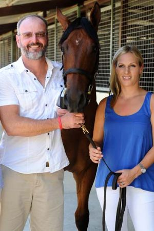 David Henderson poses for a photo with Zara Phillips at the Magic Millions Sales Complex on the Gold Coast on Wednesday. ...