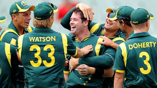 Australian bowler Dan Christian (centre) after completing a hat-trick in a one-dayer against Sri Lanka at the MCG last ...
