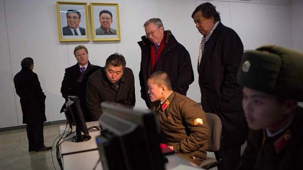Executive chairman of Google, Eric Schmidt, back row left, and former Governor of New Mexico Bill Richardson, back row ...