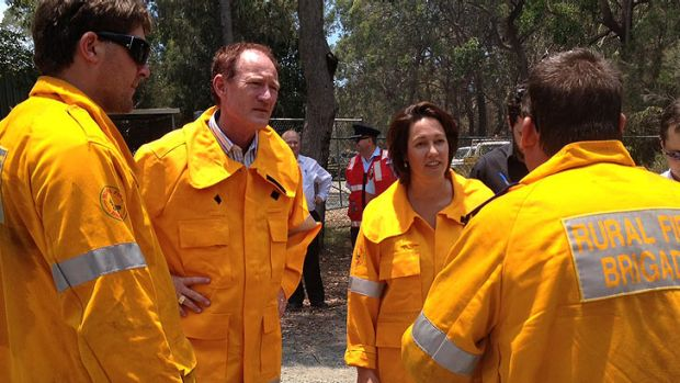 Acting Community Safety Minister Steve Dickson and Pumicestone MP Lisa France get briefed by emergency crews on Bribie ...