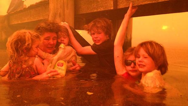 Tammy Holmes and her grandchildren, Charlotte Walker, 2, left, Esther Walker, 4, third from left, Liam Walker, 9, ...