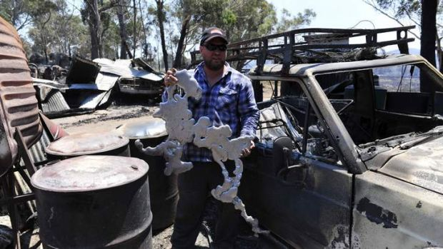 UNRECOGNISABLE: Son Mark Webster with melted metal from his property.