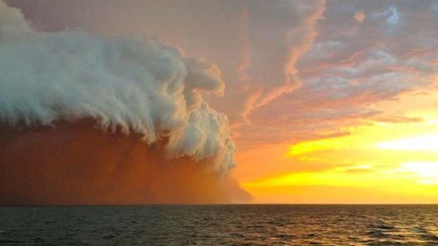 A wall of dust and water whipped up by cyclone Narelle as seen in this photo. taken by Brett Martin 25 nautical miles ...