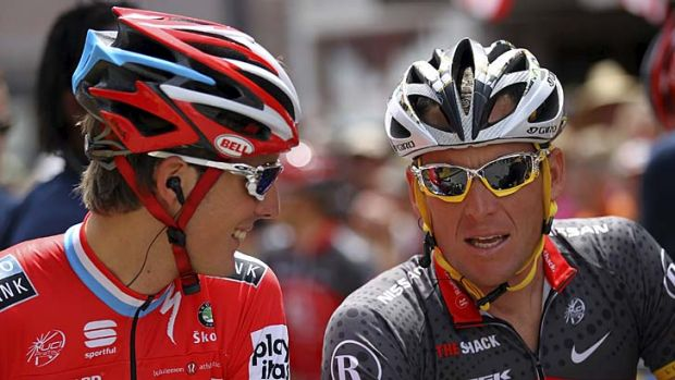 Stunned by revelations … Andy Schleck and Lance Armstrong talk as they prepare for the start of stage one of the ...